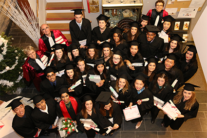 EFCM graduated students with toga and hat during 2017 Ceremony